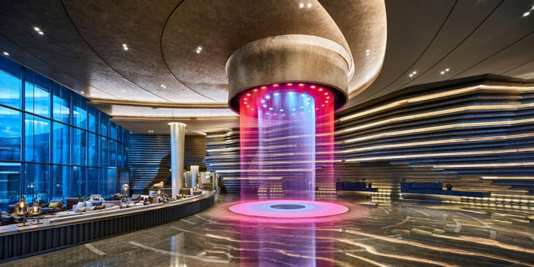 Intercontinental-Shanghai-quarry-underground-hotel-reception-design-waterfall